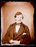 Edward C. Boynton, sitting in a suit with his arms crossed by Edward C. Boynton