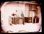 Edward C. Boynton, standing next to equipment in lab by Edward C. Boynton