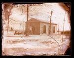 Gymnasium building, exterior, students on fence and using a maypole by Edward C. Boynton