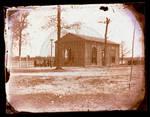 Gymnasium building, exterior, students using a maypole outside by Edward C. Boynton