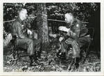 General Clayton talking to General Roach. by Author Unknown