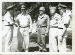 General Clayton with four unidentified men. by Author Unknown