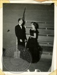 Couple in formal wear by J. R. Cofield