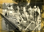 Female swimmers at a pool by J. R. Cofield