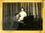 Man and woman at a Piano by J. R. Cofield