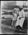 Jill Faulkner, age 4, with Mammy Callie by Unknown