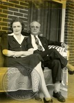 Seated older couple by J. R. Cofield