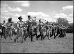 Marching band practicing in a field by J. R. Cofield