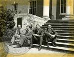Five men sitting on steps by J. R. Cofield