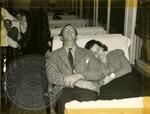 Couple asleep on the bus by J. R. Cofield