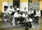 Men sitting on steps by J. R. Cofield