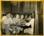 Group eating at a diner by J. R. Cofield