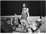 Woman decending staircase participating in a pageant at an Ole Miss dance by J. R. Cofield