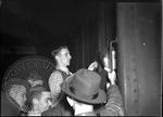 Men boarding a train by J. R. Cofield