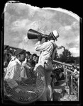 Blind Jim Ivey cheering with a megaphone at a football event by J. R. Cofield