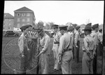 ROTC members line up for inspection by J. R. Cofield
