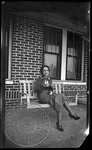 Woman on a porch swing by J. R. Cofield
