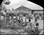 Family picnic gathering in a yard by J. R. Cofield