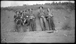 Portrait of five men with shotguns by J. R. Cofield