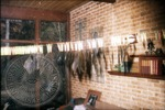 Negatives hang from a clothes line after the Cofield Studio fire, image 2 by J. R. Cofield