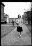 Female student walks to class by J. R. Cofield