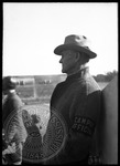Campus official with armband at a football game by J. R. Cofield