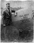 Man stands next to an airplane marked Ole Miss. Flown by Al and Fred Key. Set a new official world endurance flight record. 653 hours, 34 minutes. Meridian, Miss. by J. R. Cofield