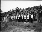 Pep rally, possibly in the football stadium by J. R. Cofield