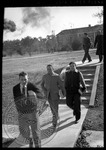 Male students walking on campus with smoke clouds in the air by J. R. Cofield