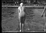 Female about to dive into a pool by J. R. Cofield