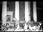 Students gather outside Lyceum for a pep rally with WMC microphone, Blind Jim Ivey in the crowd by J. R. Cofield