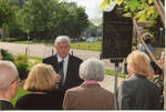 Chancellor Robert Khayat addresses unidentified guests at the dedication of the 2008 Presidential debate plaque at the University of Mississippi, image 002 by Author Unknown