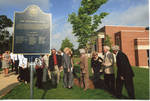 Chancellor Robert Khayat and unidentified guests at dedication of the 2008 Presidential debate plaque in front of the Ford Center at the University of Mississippi, image 001 by Author Unknown