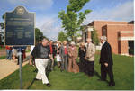 """Chancellor Robert Khayat, Dean of Students Thomas """"Sparky"""" Reardon, and unidentified guests at dedication of the 2008 Presidential debate plaque in front of the Ford Center at the University of Mississippi by Author Unknown"""