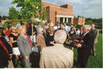 Chancellor Robert Khayat addressing the crowd at the 2008 Presidential debate plaque dedication in front of the Ford Center at the University of Mississippi; 4 copies by Author Unknown