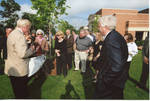 """Chancellor Robert Khayat, Dr. Andrew Mullins, Thomas """"Sparky"""" Reardon, and guests in front of the Ford Center at the University of Mississippi, image 001 by Author Unknown"""