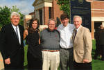 """Chancellor Robert Khayat, Thomas """"Sparky"""" Reardon, Dr. Andrew Mullins and unidentified man and woman at dedication of the 2008 Presidential debate plaque in front of the Ford Center at the University of Mississippi, image 002 by Author Unknown"""