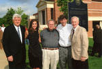 """Chancellor Robert Khayat, Thomas """"Sparky"""" Reardon, Dr. Andrew Mullins and unidentified man and woman at dedication of the 2008 Presidential debate plaque in front of the Ford Center at the University of Mississippi, image 001 by Author Unknown"""