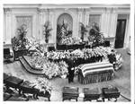 Coffin lying in state on Senate floor. by Associated Press