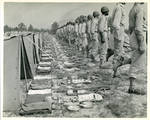 Men in military dress standing in front of tents by Peery