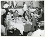 Group of women seated at table by Dennis Photos (Biloxi, Miss.)