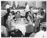 Table of women at dinner party by Dennis Photos (Biloxi, Miss.)