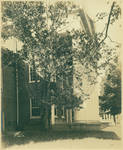 Lyceum front porch with a portion of George Peabody Hall in the distance by Author Unknown