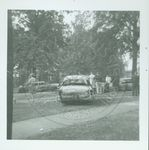 Students looking at damaged cars by W. Wert (William Wert) Cooper