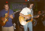 On stage: electric guitar (Les Paul), acoustic guitar by Kudzu Kings (Musical Group)