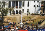 Flag parade event crowd in front of the Lafayette County Courthouse. by Author Unknown