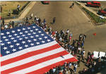 A view of the American Flag in front of the Lafayette County Courthouse, image 001 by Author Unknown