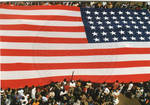 A view of the American Flag in front of the Lafayette County Courthouse, image 002 by Author Unknown