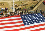 A view of the American Flag in front of the Lafayette County Courthouse, image 003 by Author Unknown