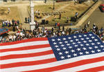 A view of the American Flag in front of the Lafayette County Courthouse, image 004 by Author Unknown